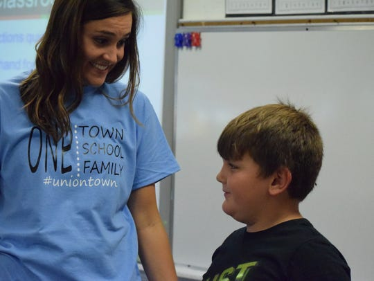 First grade teacher Amy Paris talks with ? during the