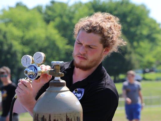 Brendan Soto from Louisville works the helium tank