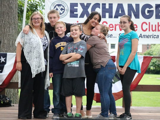 Zuriana Antonio, of Port Clinton, is swarmed by her support team after winning third place in Fremont's Got Talent at Birchard Park on Sunday.