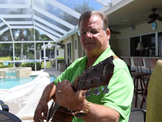 Jeff Hilt, 59, enjoys singing and playing guitar outside