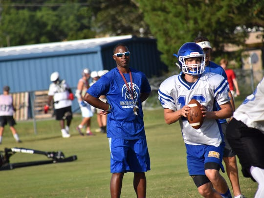 Washington High quarterback Joe Slattery runs a play