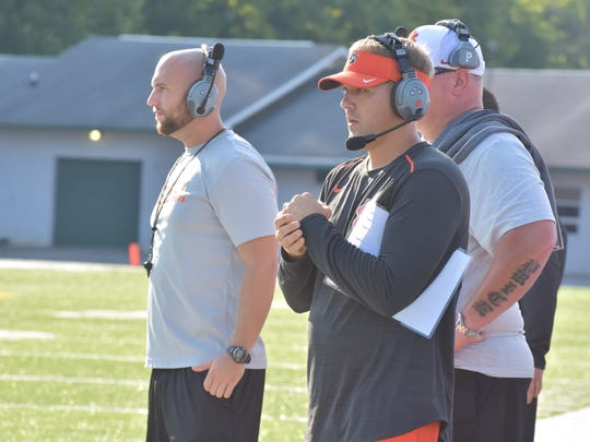 Powell head football coach Rodney Ellison (center) during a pre-season scrimmage against Carter in 2017.