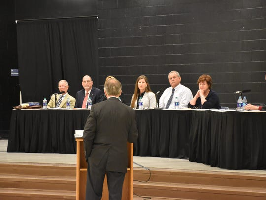 Members of the Santa Rosa County School Board listen