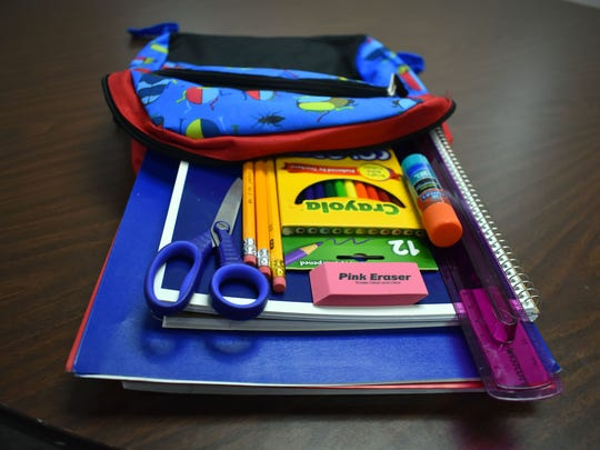 An estimated 400 bags full of basic staples every student needs were given away Friday during the fifth annual Love INC. school supply giveaway at Grace United Methodist Church.