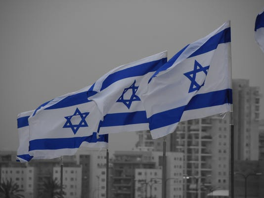 Set of Israeli  flags on a city background