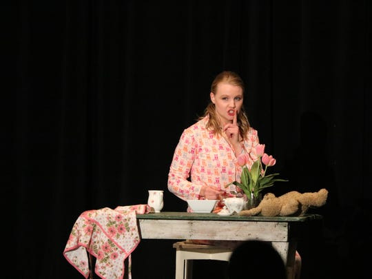 Emily Davis performs a monologue as her talent during the competition.