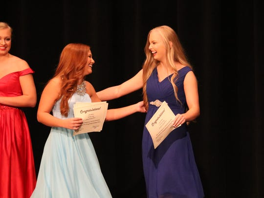 Jamee French (left) and Macey Simpson (right) celebrate as they are announced the talent winners.