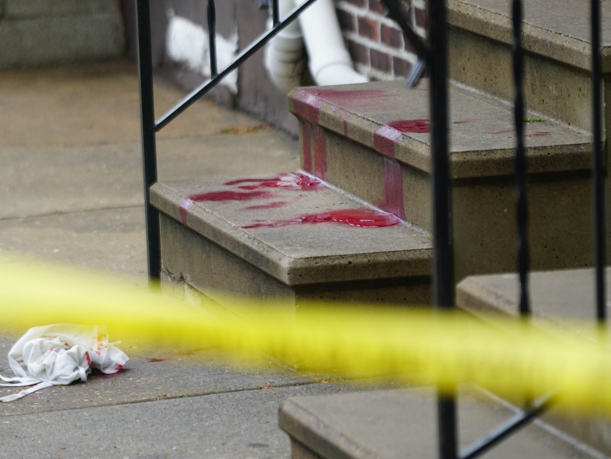 Blood from a young man shot in the arm remains on the