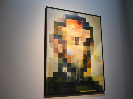 """Salvador Dali's, """"Gala contemplating the Mediterranean Sea."""" The artwork transforms into a portrait of Abraham Lincoln from 20 meters away. It's one of his many works displayed at The Dali Museum in St. Petersburg."""