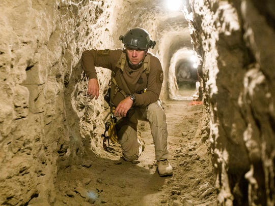 Border Patrol agents give a tour of a tunnel discovered in December 2009 that's about 762 feet long and 70 feet underground in the San Diego area.