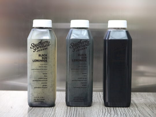 A black sun lemonade offered by Southern Pressed Juicery.