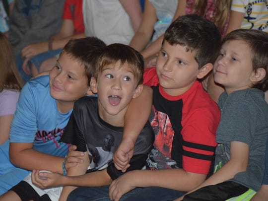 U.E.S. students from left, Mat Bolden, Parker Thompson, Tucker Hash, and Jayden Grissom eagerly anticipate the big reveal.