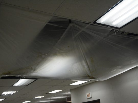 Rainwater seeps through a Visqueen sheet staff put up to prevent leaks at the Eudora Welty Library in Jackson.