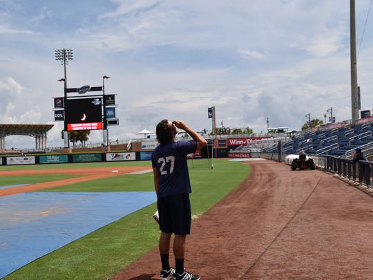 Blue Wahoos reliever Zack Weiss stares at the sun through