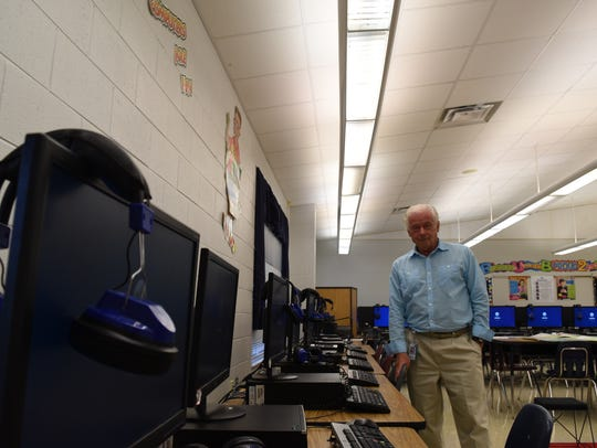 Granville Thompson poses in his technology classroom