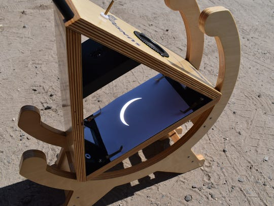 The Klingers used a sunspotter solar telescope to safely view the eclipse before totality.