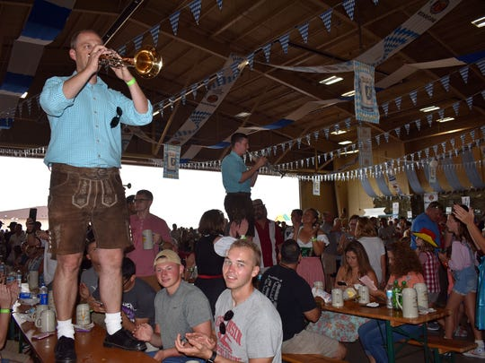 Members of the The Pressather Musikanten perform on tables during the 21st annual Oktoberfest at Holloman Air Force Base.