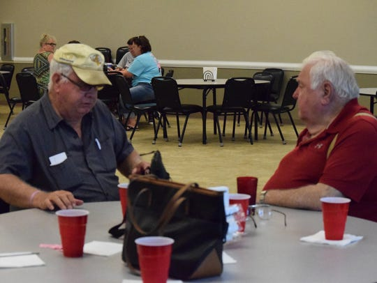 Donnie Greenwell (left) and Bobbie Cowan join in conversation