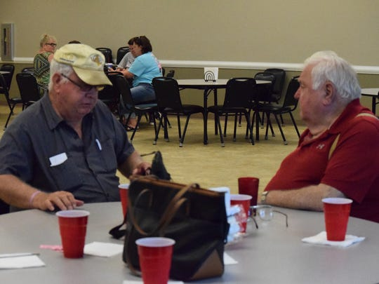 Donnie Greenwell (left) and Bobbie Cowan join in conversation during the senior event.