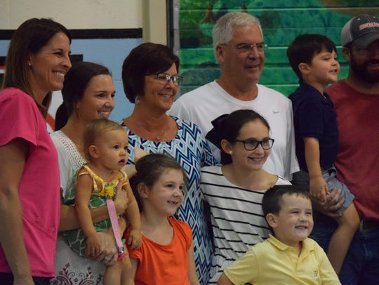 Leslie Willett smiles for a group photo with family