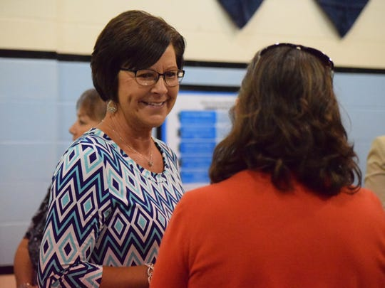 Leslie Willett smiles as she socializes at the retirement party held in her honor.