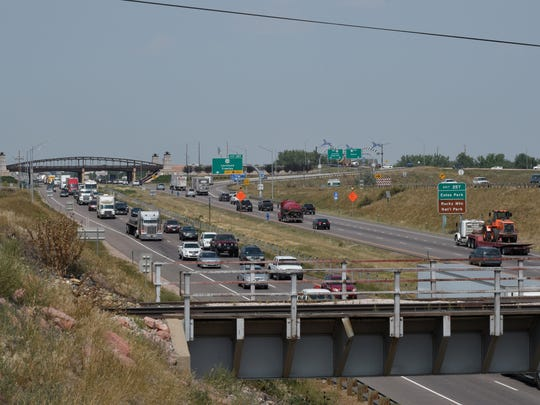 Traffic was heavy Friday afternoon on Interstate 25 by the East County Road 20 E overpass ahead of the Rocky Mountain Showdown in Denver.