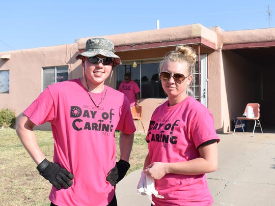 Volunteers stand for a photo Friday as they help the community for the 26th annual Day of Caring.