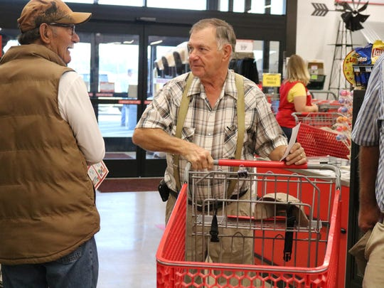 Larry Terrell (left) and Bill Owen (right) visit with each other during the grand opening.