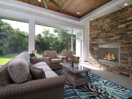 A fireplace surrounded by stone makes a comfy sitting