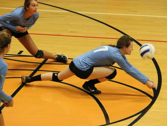 Hannah Turner slides to the ground to save the ball