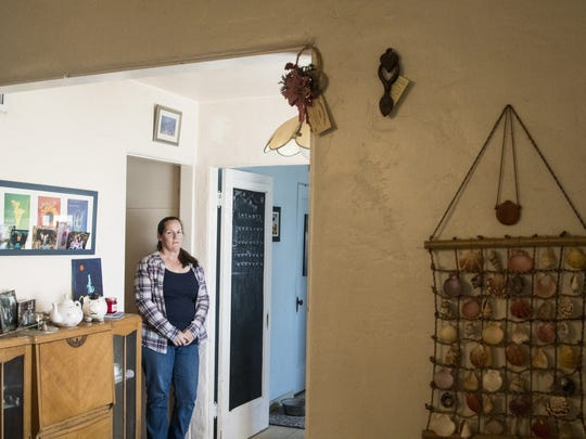 Christine Close, pictured inside her home in Mesa's West Side-Clark Historic District, has been working for 13 years to achieve local historic status.