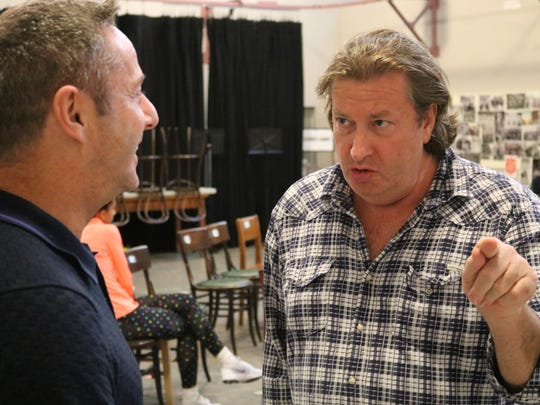 Choreographer Stephen Mear (left) listens as director