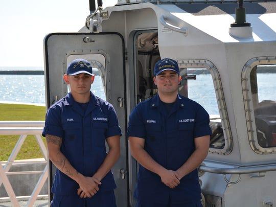 Coast Guard Seaman John Flora, left, and Petty Officer