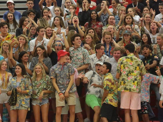 A loud crowd of Xavier Prep fans cheer for their team, Thursday, September 21, 2017.