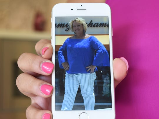 Sarah Owen holds a digital photo of her mother, Marilyn Villarreal, who is a breast cancer survivor. Owen is the development director for the Susan G. Komen Southwest Florida.