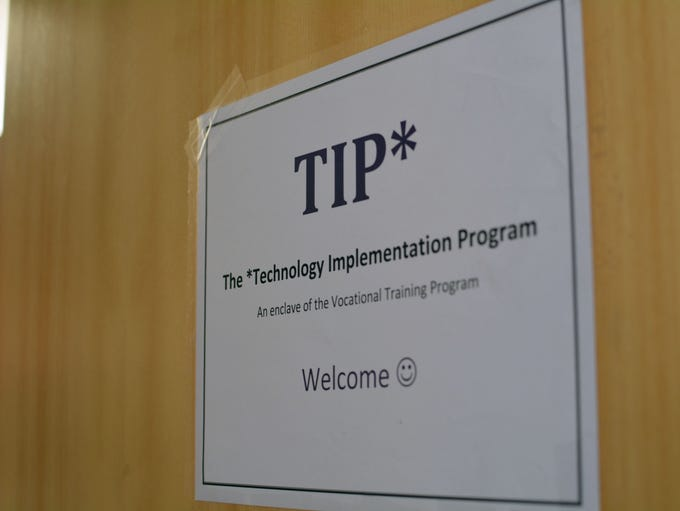 A sign on the door of the small room where the Technology