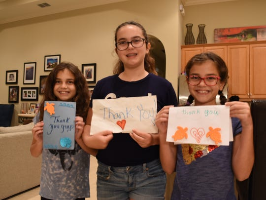 From left to right, Olivia Dooney, 9, Rachael Dooney, 12 and Samantha Dooney, 9. The Dooney sisters helped write 'thank you' cards to emergency personnel for their Hurricane Irma response.  The 'thank you' cards were shown in a three-minute video created by 9-year-old Samantha.