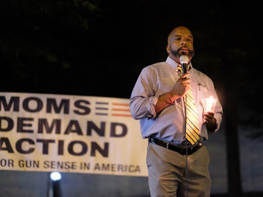 Representative Rick Staples of TN House District 15 gives his remarks during the candle light vigil held in Krutch Park in support for the victims of the Las Vegas shooting on Wednesday, October 4, 2017.