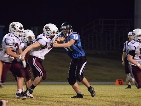 Peyton Snyder attempts to hold back his Henderson County