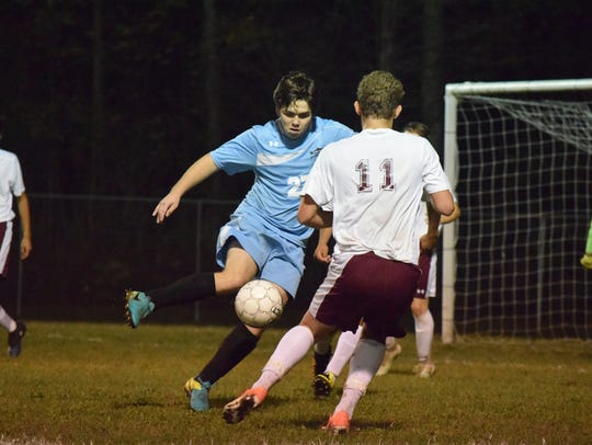 Coy Burns tries to steal the ball back from Webster