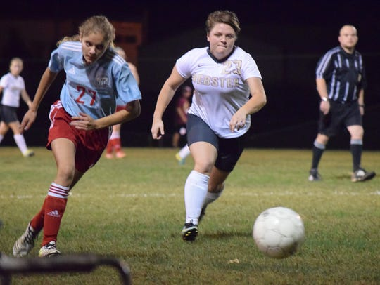 Union County's Lera Adams eyes the ball in as she races