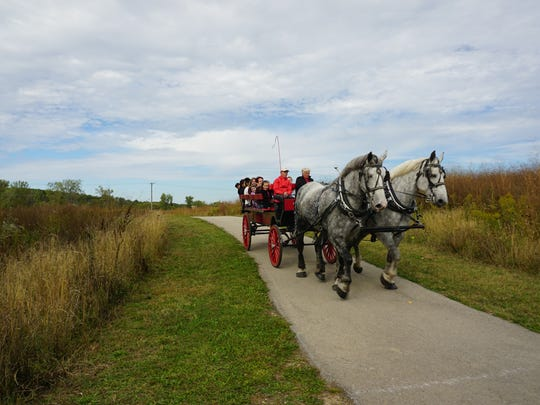 "The city of St. Francis 'Nogoshing"" Trail was toured with horse and wagon at the Oct. 1 event. Riders learned about the Native American heritage of the trail as well."