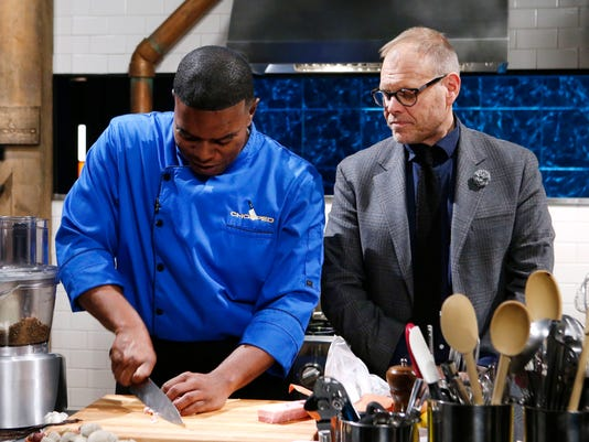Alton-Brown-checks-in-on-a-chef-Nick-Wallace.JPG