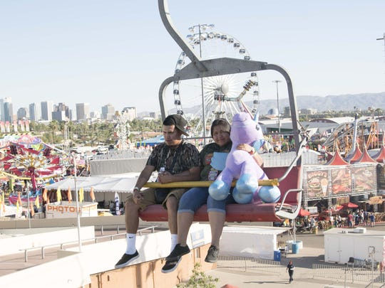 Family enjoy rides and other fun activities at the