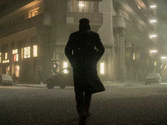 Officer K (Ryan Gosling) walks in the Los Angeles snow in 'Blade Runner 2049.'