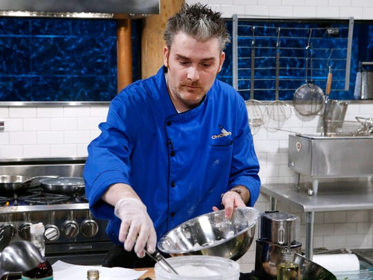 Chef Christopher Holland cooks with transparent ravioli,