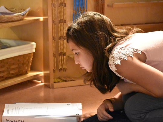 Irene Kirifides, 11, works on a math problem at Wilmington Montessori School. Leaders there recently announced the school would be expanding into middle school.