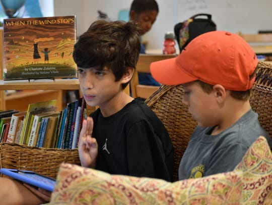 Logan Ranji, 11, writes a blog post about the Miami