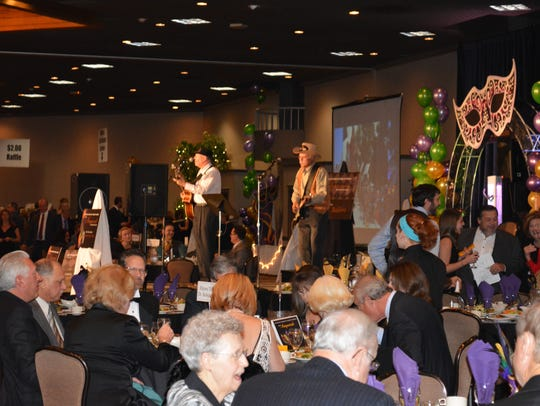 Entertainers from a past chamber gala auction.