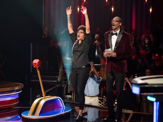 A contestant seeks a $25,000 prize as host Snoop Dogg and a studio audience watch on TBS' 'Snoop Dogg Presents The Joker's Wild.'